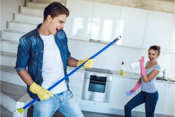 Couple cleaning together