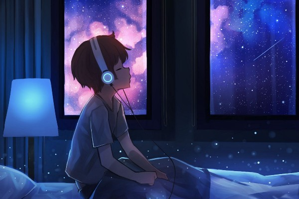 Boy listening to music to calm anxiety.